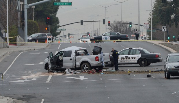 Law enforcement personnel continue their investigation into a traffic incident on Somerville Road near Delta Fair Blvd. in Antioch, Calif., on Wednesday, Jan. 17, 2018. Several people, including a baby were injured in the crash. A white truck involved in the accident is reportedly a stolen vehicle and may have been trying to evade police. (Dan Honda/Bay Area News Group)