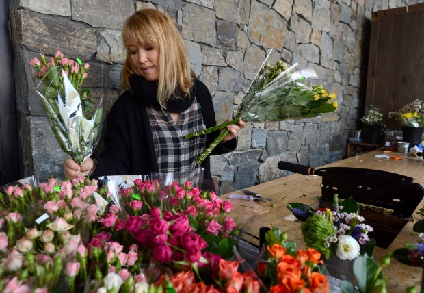 Sibhan Stokes, flower manager, prepares flowers for sale at Diablo Foods in Lafayette, Calif., on Thursday, Jan. 25, 2018. Diablo Foods is celebrating its 50th anniversary in 2018. The neighborhood grocer still maintains a loyal following, even in the shadow of the big store chains. (Dan Honda/Bay Area News Group)