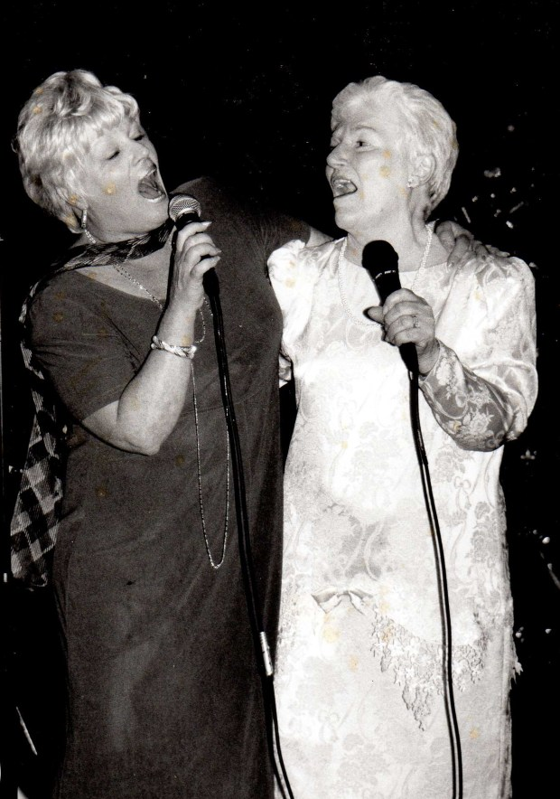 Nancy Gannon-Mongerson, left, is photographed singing with her mother, Clara Cox, in 1997. (Courtesy Darleen Sherman)