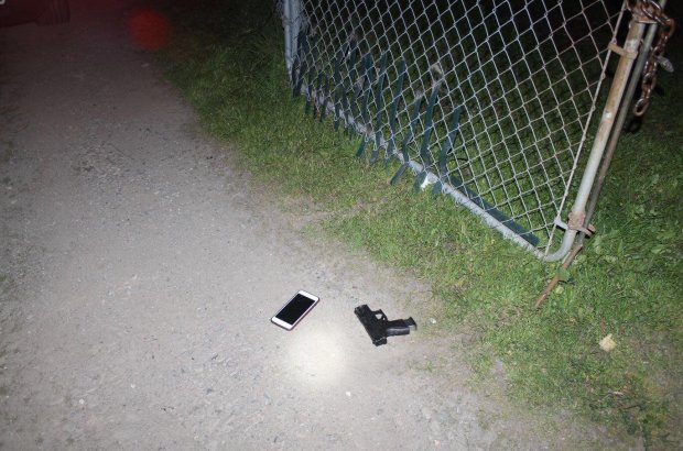 Richmond police shared this image Wednesday, Feb. 14, 2018 of a handgun and an iPhone that fell to the ground after a suspect foot-chase ended at a fence Tuesday night.