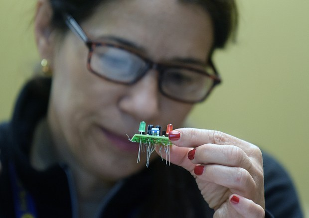 Teacher Carmen De Jesus from Walnut Creek Intermediate School assembles a circuit board during a soldering class at the 2018 MDUSD/East Bay CUE's STEM and EdTech Symposium at Valley View Middle School in Pleasant Hill, Calif. on Saturday, Feb. 24, 2018. The event features cutting-edge educational technology. (Sherry LaVars/Special to the East Bay Times)
