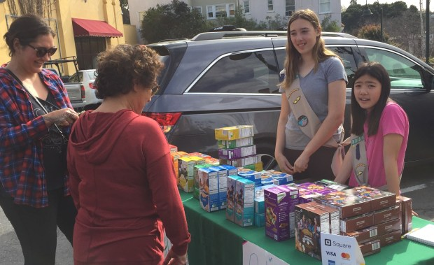 Girl Scout Cadettes Katarina Melian and Rina Higashi sold cookies at Fentons Creamery on Piedmont Avenue on Feb. 4. The sixth-grade troop will be selling cookies in front of Safeway on Grand Avenue from 10 a.m. to 4 p.m. Feb. 11. (Courtesy of Shari Fujii)