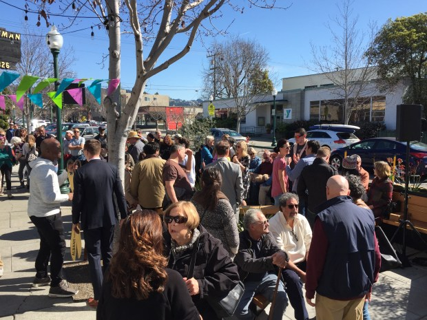A crowd celebrates the Feb. 25 grand opening of Albany's first parklet, which is also the first bus stop parklet in the country. (Jennifer Modenessi/For Bay Area News Group)