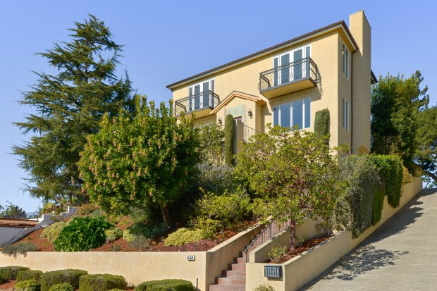 The Upper Rockridge home delivers incredible bay and city views from the formal living room.