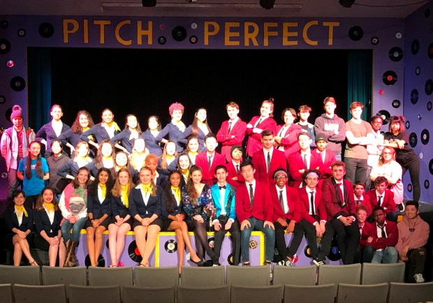 "The Alameda High School cast of ""Pitch Perfect: The Musical"" gathers for a group photo during rehearsals. The musical production will run from March 9-17. (Courtesy of Megan McKinley Beaudreau)"