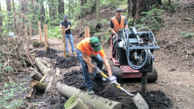 Oakland Trails volunteers work with the Oakland Public Works staff to repair a trail in the Oakland hills. (Courtesy of Stan Dodson)