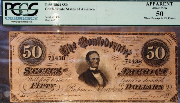 Chris Treadway/for Bay Area News GroupAlong with coins, longtime Alameda collectibles shop The Silver Baron has historic currency, including this Confederate $50 bill from the Civil War.