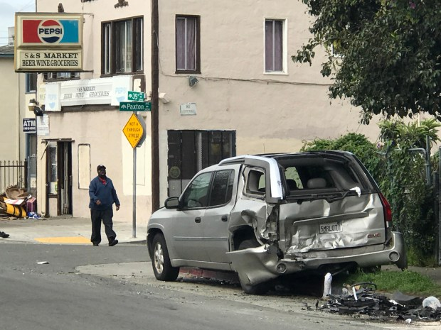 A damaged silver GMC minivan sits Wednesday, April 11, 2018 on the west-side curb of the 2250 block of 35th Avenue in Oakland, California. The GMC was one of several vehicles struck during a Tuesday night injury collision.