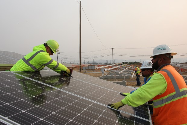 Workers install solar panels at the Solar One project in Richmond. (Courtesy of Marin Clean Energy.)