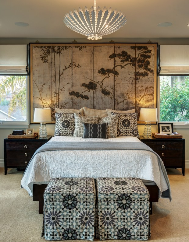 Treve Johnson PhotographyThe bold and varied patterns used in this bedroom are just a part of the eclectic mix of furnishings and decor that define this newly built Mediterranean home.