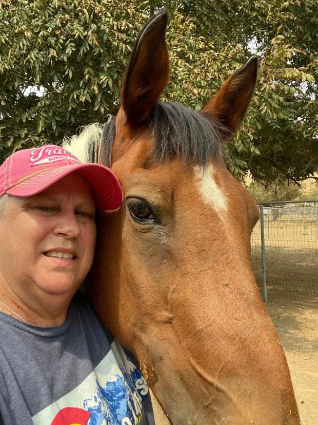Katrina Stone poses with her horse ...