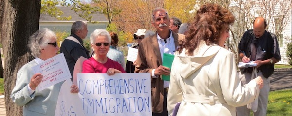 Supporters of immigration reform, some from Organizing for Action on the North Fork, at a similar rally in Southampton in May | OFA North Fork photo
