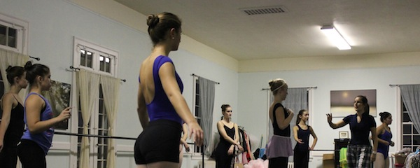 "Megan Callahan (right) gives some last minute pointers to the dancers in this year's production of ""The Nutcracker."""