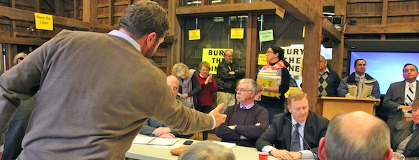 CCOM Executive Director Jeremy Samuelson offers a handshake bargain to stop work on the overhead transmission lines to PSEG President David Daly in East Hampton Wednesday