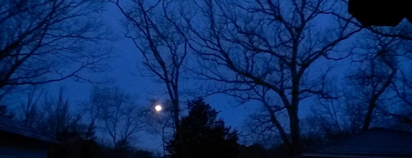 April's full moon setting at dawn.