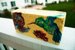 An example of Caitlyn Shea's process for drawing on paper affixed to bricks.
