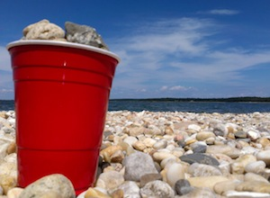 The correct perspective on East End summer beachgoing. And also, rocks are not edible.