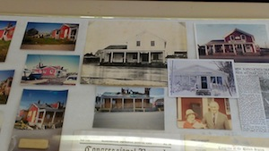 A montage of photos of the old New Suffolk Post Office and general store hangs in the current post office, farther south on First Street.