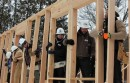Raising the second wall of the first Habitat for Humanity house in Orient.