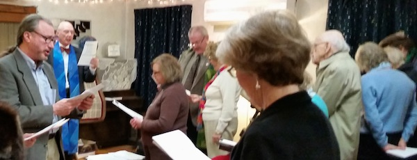 The congregation of Southold's First Universalist Church crowded into Custer Institute Sunday morning, after their church burned down last weekend.
