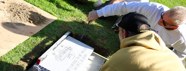 Southold Town's Mike Eckhardt and Rusty Ackroyd centered the time capsule marker Tuesday morning.