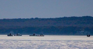 The opening day scallop regatta off Robins Island at dawn.