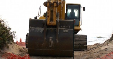 A track excavator blocks the entrance to the Montauk beach construction site.