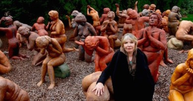 """South Fork Sculptor Sarah Lowenstein with her sculpture, """"Dark Elgy,"""" of family members of the victims of Pan Am 103"""
