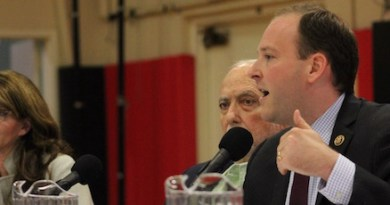 Anna Throne-Holst, moderator Peter Lowenstein and Lee Zeldin at Sunday's debate.