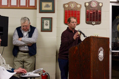Art Tillman (left) listened to Bill Wright (right) speak at Thursday's meeting.