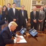 President Donald Trump signed executive orders in January while White House Chief Strategist Steve Bannon looked on | White House photo