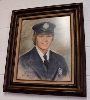 "Edward ""Bruce"" Bellefountaine in a 1977 portrait by Andre Bouche in the Greenport Firehouse meeting room."