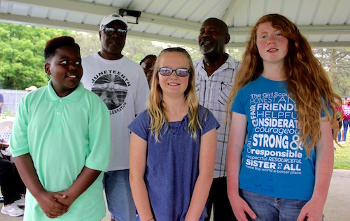 """Juneteenth essay contest winners (front row, left to right) Andy Mardice, Shannon Noone and Beatrice Stefan, with Larry Williams (back left) and Robert """"Bubbie"""" Brown (back right)."""
