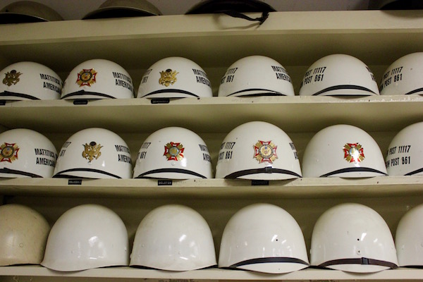 Parade helmets on a shelf...