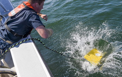 U.S. Naval Academy Midshipman 1st Class Nolan Brandon launches a remotely operated vehicle during a survey of the wreck on Sept. 13. | U.S. Navy photo by George Schwarz, Ph.D.