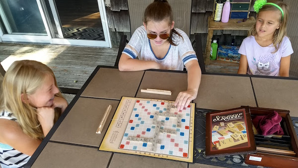 From left: Jennifer Luke, her friend Jane Rocco and little sister Violetta Luke play Scrabble over their summer vacation. | Jennifer Luke photo