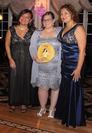 SEPA Mujer Executive Director Martha Maffai presents Riverside Rediscovered's Angela Huneault and Siris Barrios with their award.