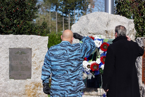 Post Commander Bobby Neudeck and William Goggins salute the wreath laid to honor departed veterans.