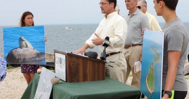 Environmentalists, including Bob DeLuca of Group for the East End (center) at the announcement of the lawsuit at Orient Point in July 2016.