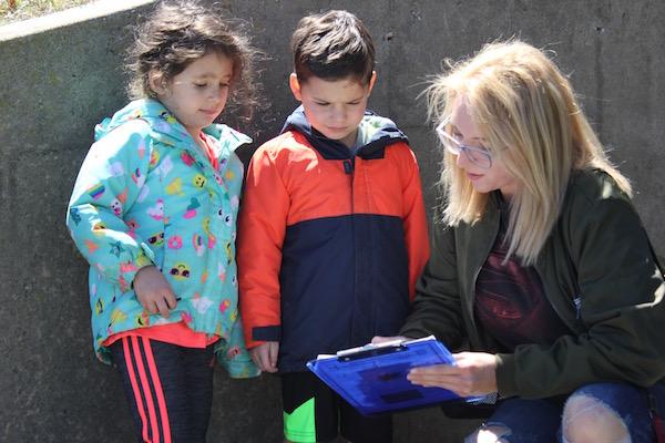 Allie Kaiden, Leo Kaiden and Anika Schneider at SoFo's Earth Day scavenger hunt.