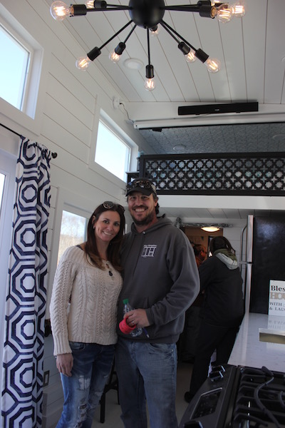 Mark and Jessica Dunkirk of Tiny Hamptons Homes show off their Bridgehampton model tiny house at Southampton Town's Electric and Hybrid Car Expo at Good Ground Park in Hampton Bays