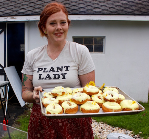 Jess Morris of the North Fork Roasting Company with her dandelion donuts, freshly baked and still warm.