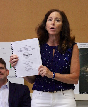 Adrienne Esposito with a copy of the Department of Health report.