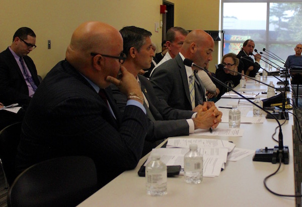 Suffolk County Chief of Detectives Gerard Giganta (third from left) spoke, as Homeland Securities Investigations Special Agent Angel Melendez (at left) looked on.