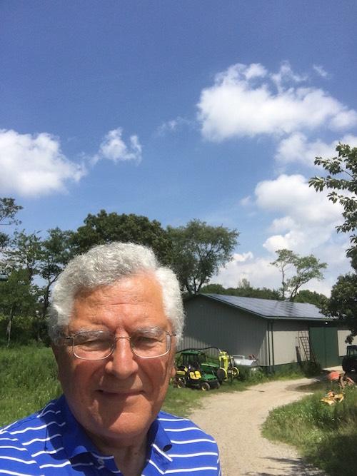 Charles Massoud of Paumanok Vineyards with his vineyard's new solar panels.
