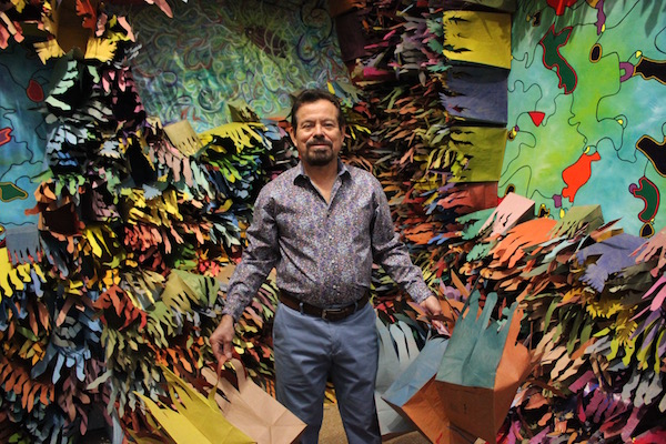 Artist Francisco Alvarado-Juárez installing the exhibition in late October.