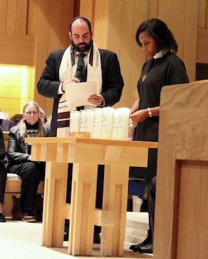 Rev. Leandra Lambert of St. Luke's Episcopal Church in East Hampton lit a candle for shooting victim David Rosenthal