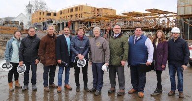 Leaders met at the downtown Riverhead work site of Riverview Lofts on March 22.