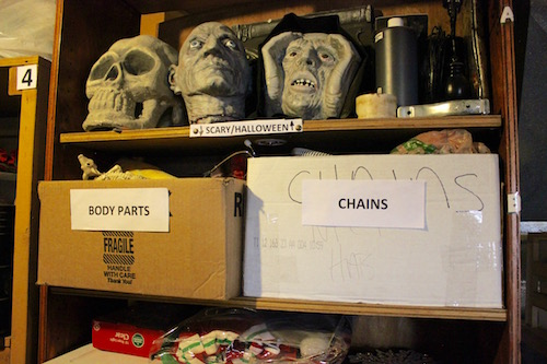 Props are being reorganized in the attic storage area.