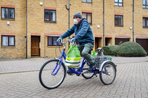 Local resident John and his dog Millie delivering shopping for vulnerable residents